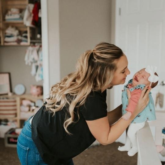 nurse feeding newborn